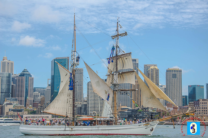 Tall ship with a backdrop of Sydney skyline.
