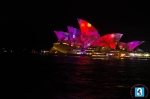 Blazing red and magenta flashes at the Sydney Opera House.