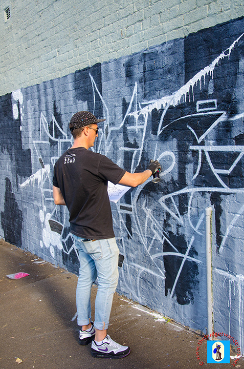 A professional street artist makes his masterpiece in Glebe.